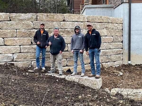 Gradex stone retaining wall installer team picture