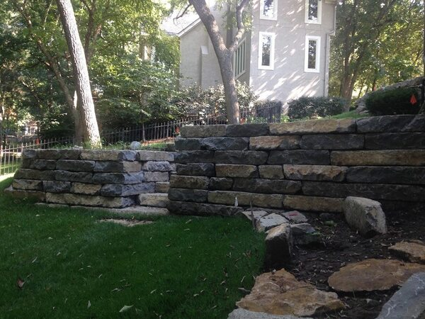 Large stone retaining wall with steps