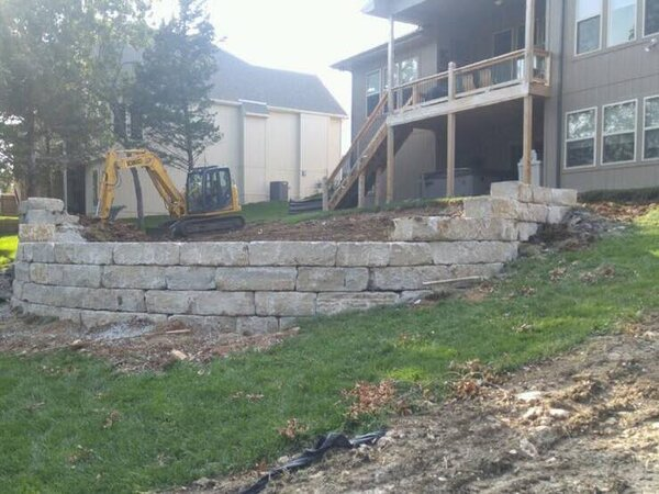 Limestone wall for a pool yet to be installed with a Infiniti edge lowered patio