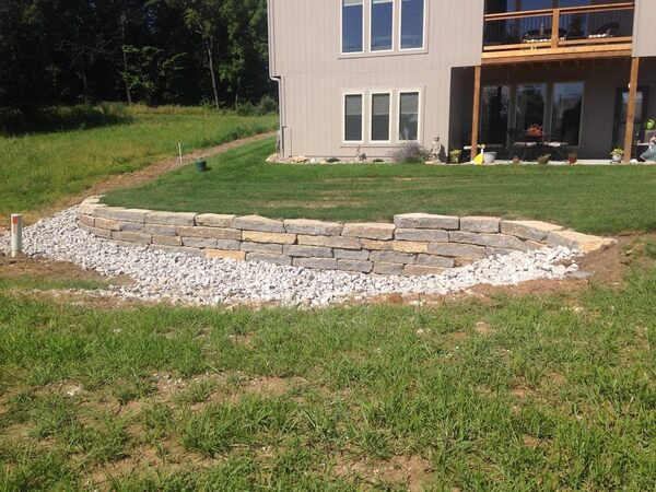 Retaining wall for drainage control