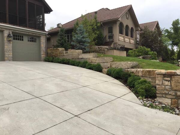 Tiered retaining wall edging a driveway