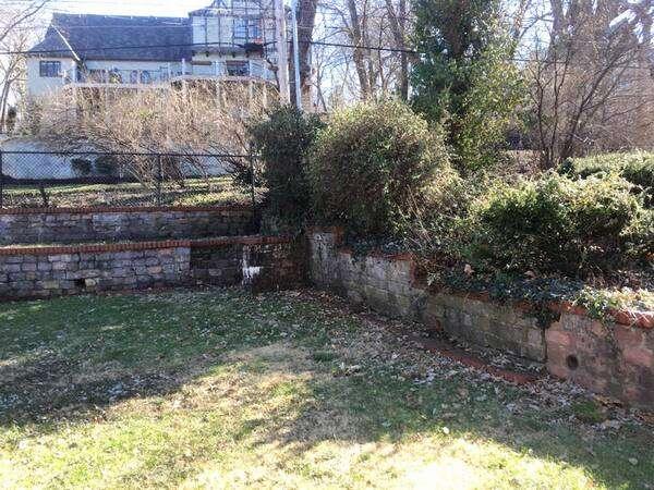 Old overgrown stone retaining wall